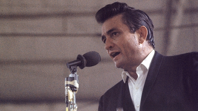 """Country singer Johnny Cash performing for prisoners at the Folsom Prison in California on January 13, 1968. The performance was recorded for his live album """"Johnny Cash at Folsom Prison.""""  (Credit: Dan Poush/AP Photo)"""