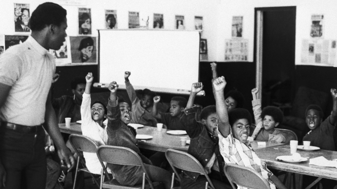 A teacher and his at a Black Panther liberation school. (Credit: Bettmann Archive/Getty Images)