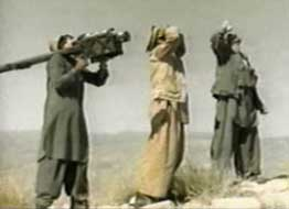 Mujaheddin preparing to fire a stinger missile.