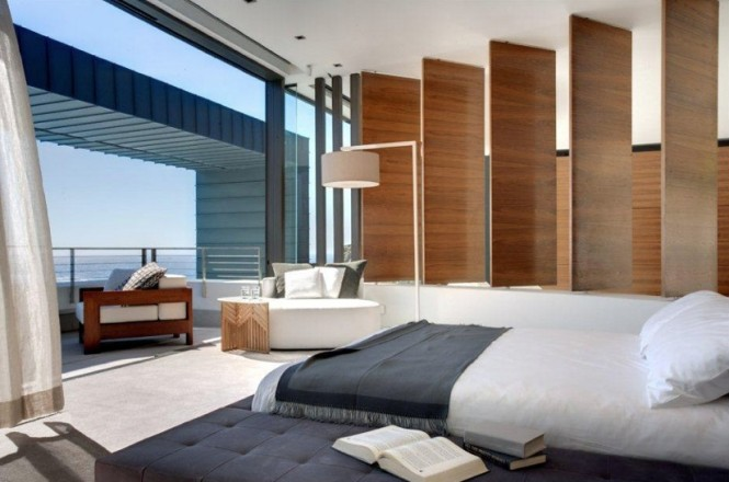 Contemporary neutral bedroom with balcony