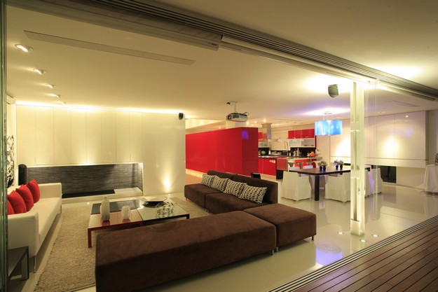 Brown modular L shaped safa white lounge  Interior Design Ideas