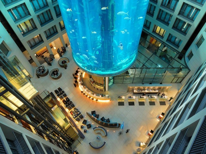 Nestled beneath a colossal, cylindrical aquarium that reaches up several stories high, the central core of the Radisson Blu Hotel in Berlin is a spectacle to behold.