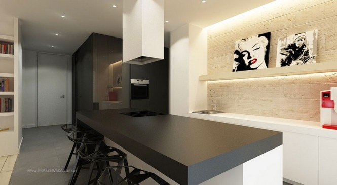 The masculine straight lines in this kitchen layout are given a feminine kick with accents of lipstick red.
