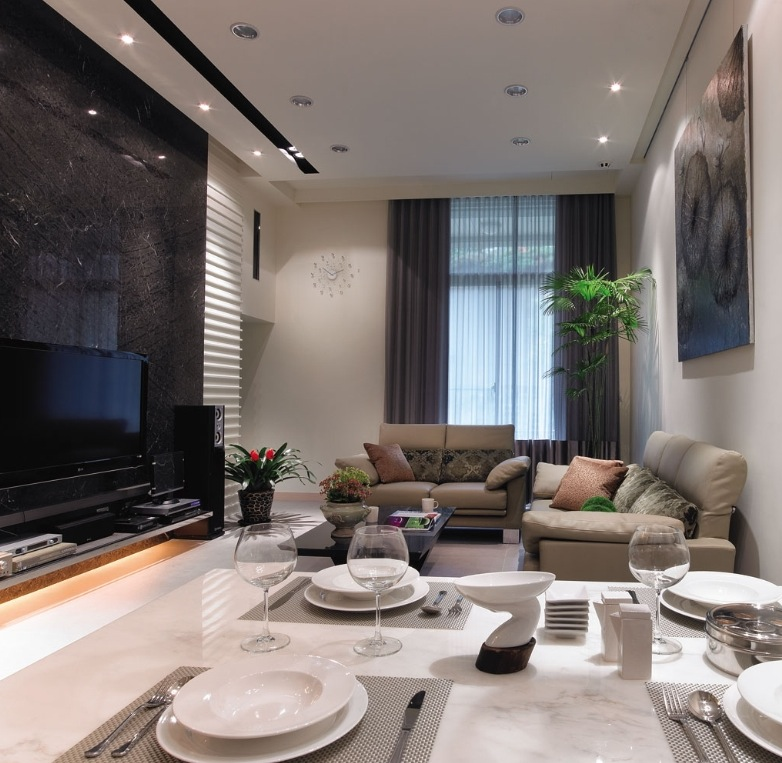 small open plan kitchen diner living room grey and silver curtains adding interest to neutral decor