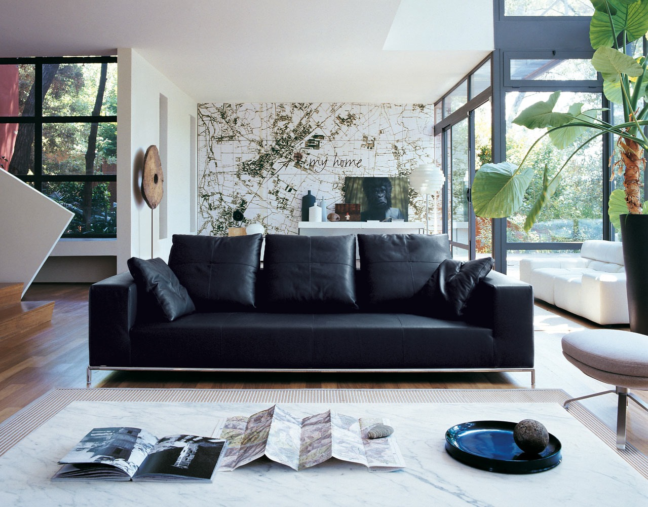 living rooms with black leather sofas swivel chairs for room contemporary sofa interior design ideas