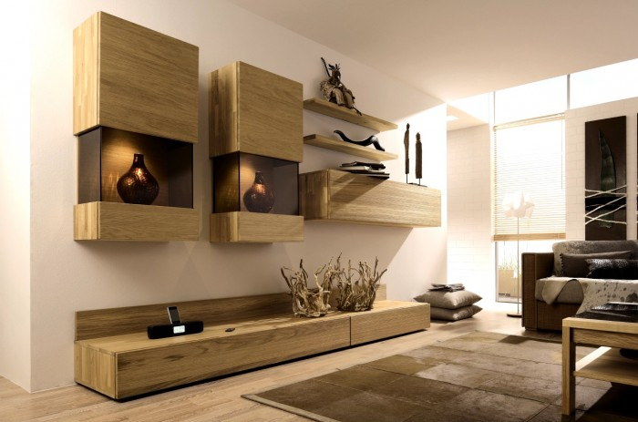 This minimalist media wall grouping makes quite an impression with wall cabinets, a low profile tv and accent piece and a series of staggard wall shelves.