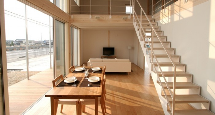Sliding doors allow the exterior and interior of this Japanese city loft to organically meld one into the other.
