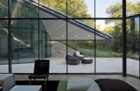 paneled glass walls of pit