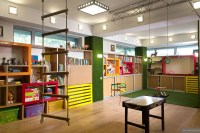 brightly colored childrens playroom with suspended swings ...
