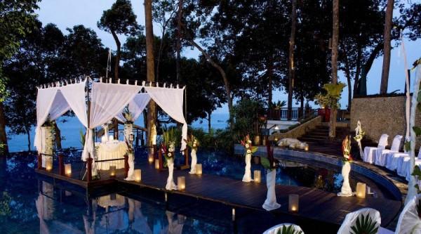 romantic over pool floating dining in white gazebo