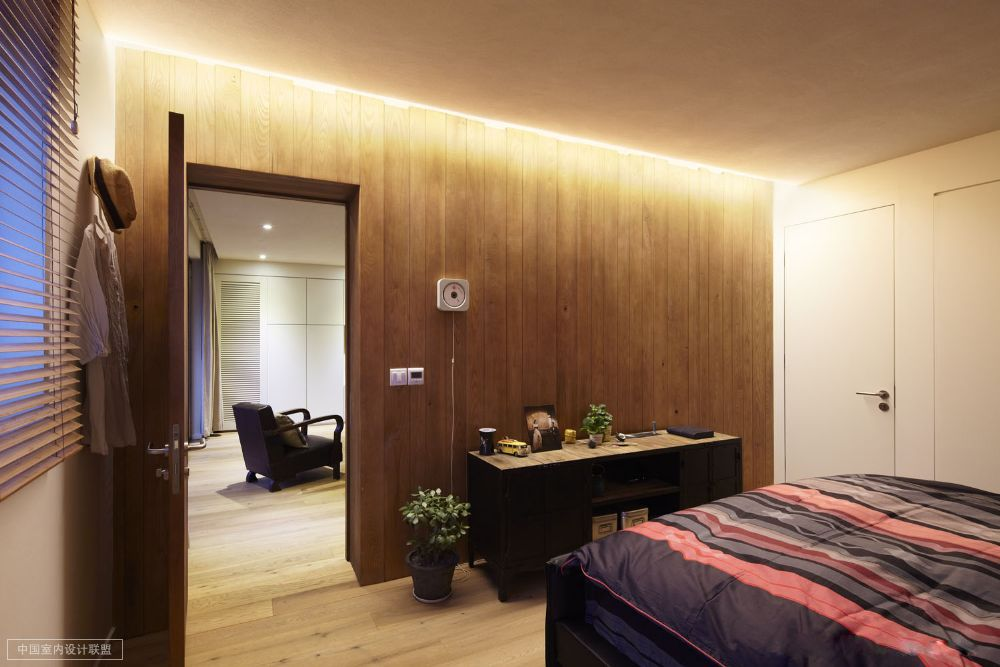 Simple Bedroom Warm Wooden Cladding And Occasional Chest Topped And Flanked With Jade Plant