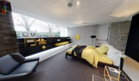 yellow and grey bedroom with fitted storage and black ...