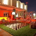 Lit yet fun outdoor living space with life size chess board