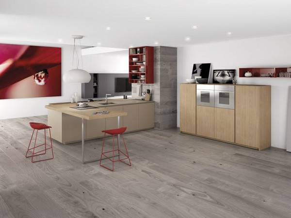 This modern kitchen is not fussy or complicated. Instead, a small counter area, with a bar that juts out playfully, gives just enough room to cook a simple meal or enjoy a cup of coffee without a lot of overhead.