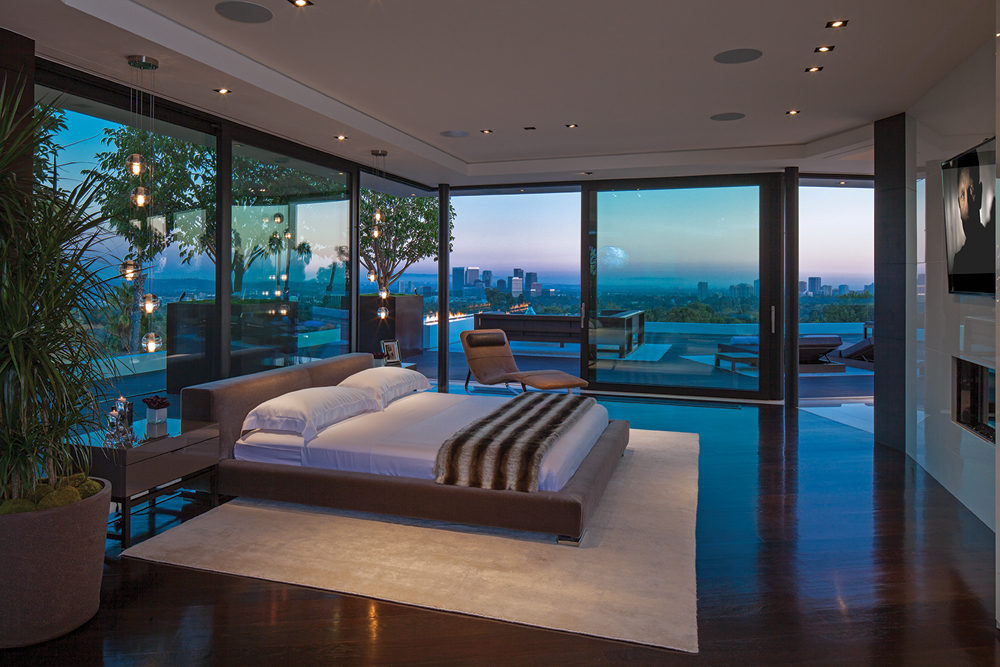 Glass walled bedroom
