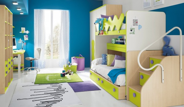Storage steps offer up deep drawer space, along with another run under the bunk-beds. The lime green looks electric against bright blue, and purple accents prevent the overall scheme from looking too boyish.