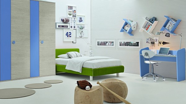 Gray accents give this space a cool look for an older boy, and the grass green bed adds a sporty feel to the otherwise blue colored room.
