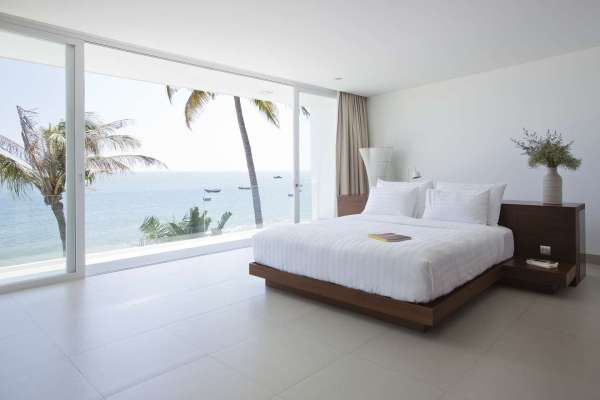 modern bedroom with ocean view Private Beach Villas Offer Spectacular Ocean Views and Luxurious Interiors