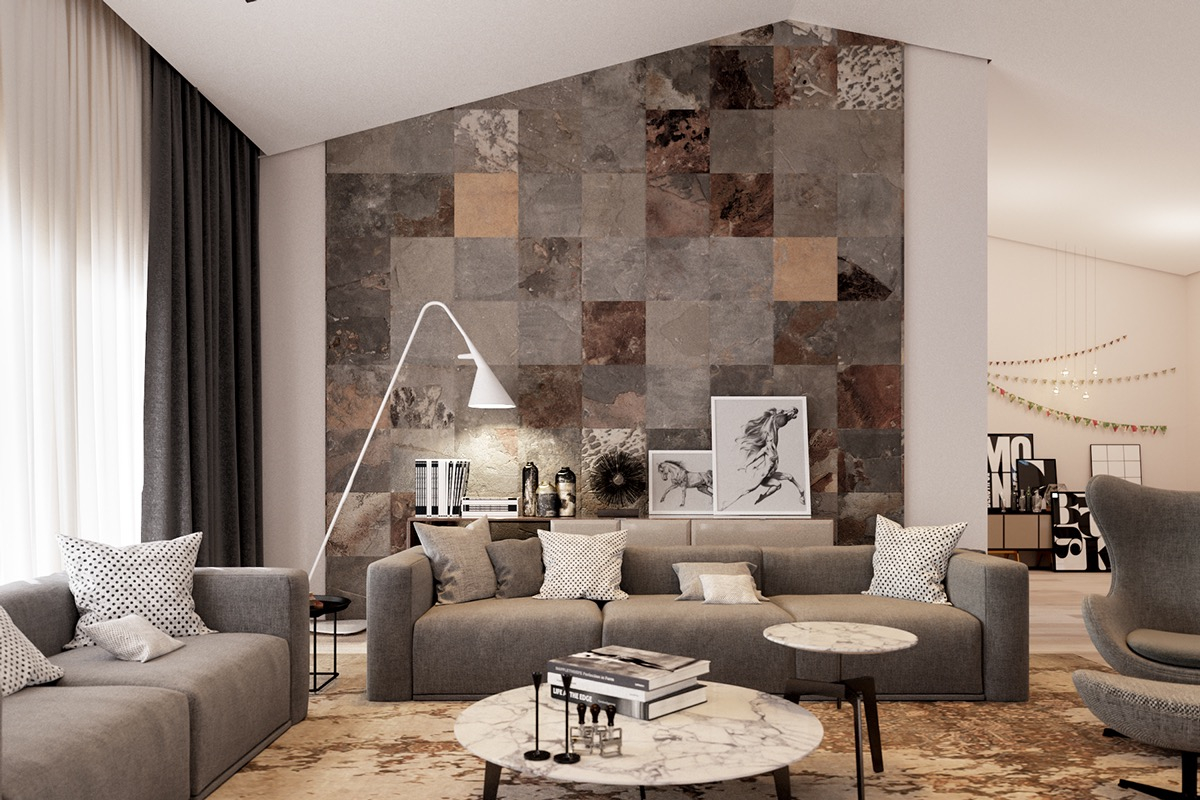 A brilliant arrangement of tiles adds color and variety. This fabulous accent wall accomplishes its purpose by drawing the eye and uniting the subtle patterns and textures used throughout the space.