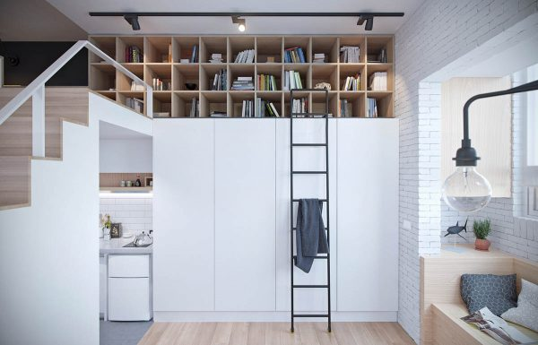 Storage is always a question to address in a studio like this one which measures just 22 square meters but this lofted storage area is a creative and