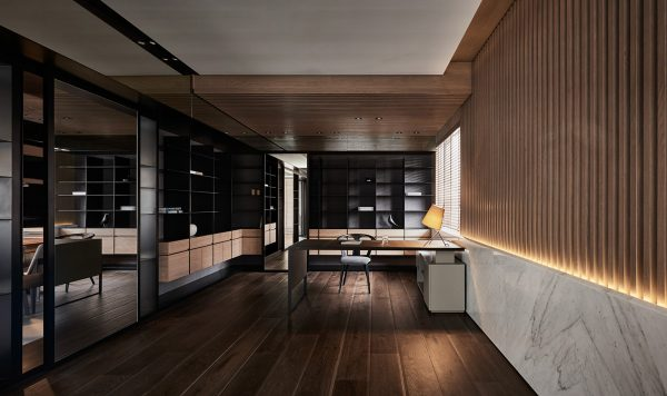 Stone And Wood Make A Dark Masculine Interior: Black Acrylic, Glass And Stone Form This Dark And