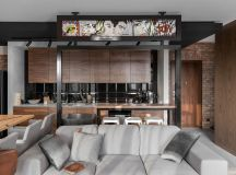 Three Homes Using Exposed Brick, Wood Panelling and Grey To Their Advantage images 22