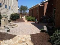 Traditional Patio in Duluth - dark mulch, stone paver ...