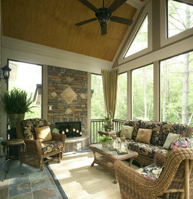 Traditional Sunroom Photo  area rug stone fire place