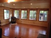 Rustic Sunroom in Rosemount - dark wood floor, rustic wood ...
