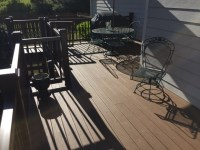Traditional Deck in Alpharetta - gray siding, green metal ...