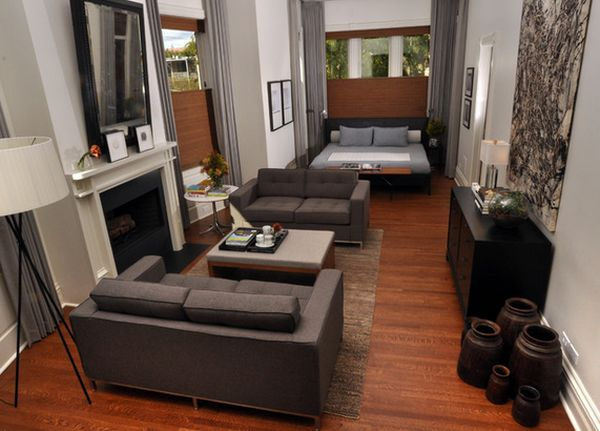 how to decorate a long living room with fireplace in the middle small storage ideas arrange furniture narrow view gallery
