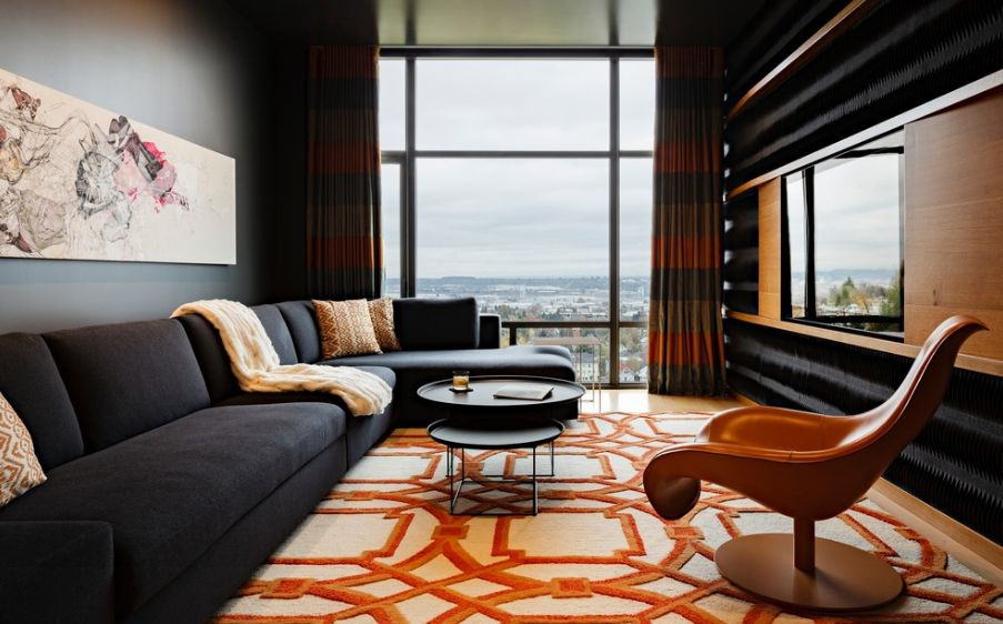 dark sofa in small living room roche bobois mah jong modular cost 8 ways to lighten up a and gloomy space with walls furniture add large rug or carpet that features light colors this one cheery orange accents simple but