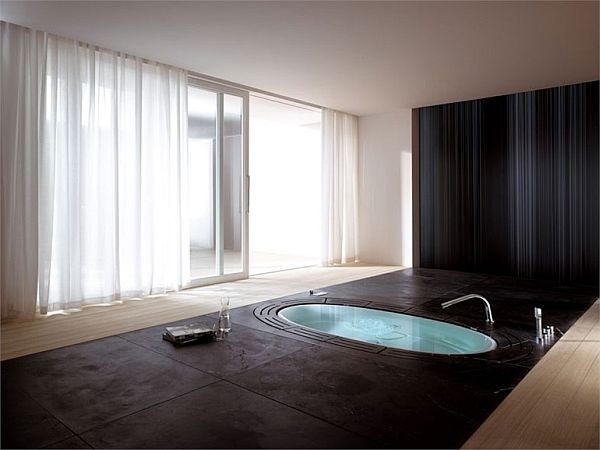 Modern Bathroom Design Oval In Ground Built In Bathtub Bath Tub With Dark Floors and Walls and Curtained Sliding Glass Doors