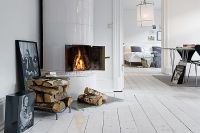 Inviting White Swedish Apartment With Vintage Fireplaces