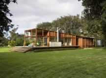 Private residence surrounded by large Puriri trees