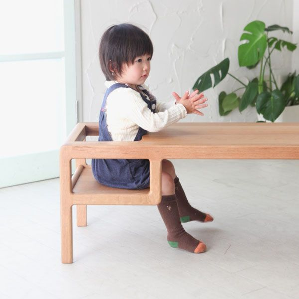 A table with builtin baby seat by Toa Ringyo