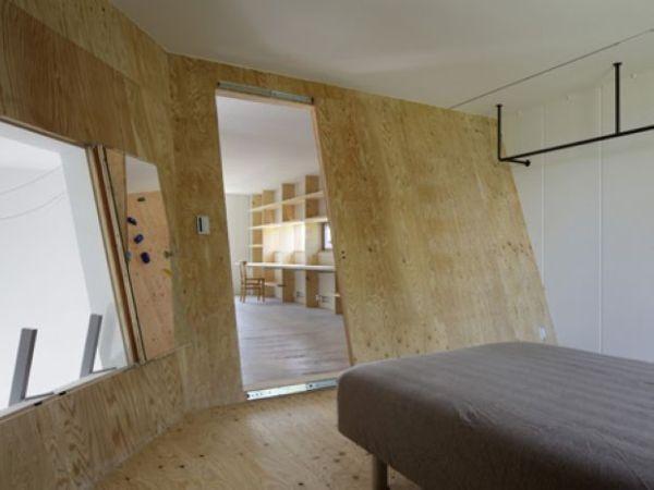 Modern homes featuring a rockclimbing wall