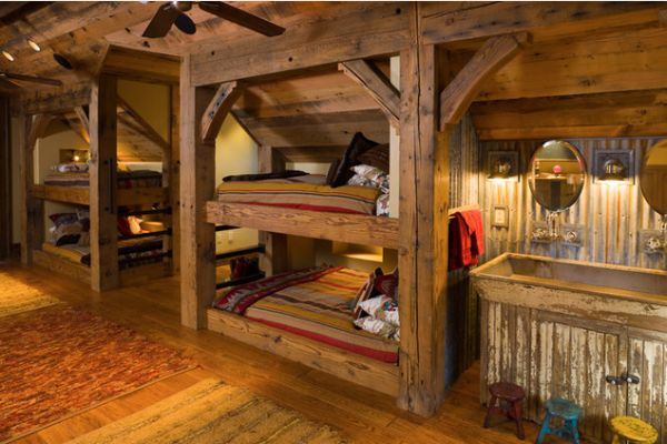 Rustic wooden bunk beds placed on floor level
