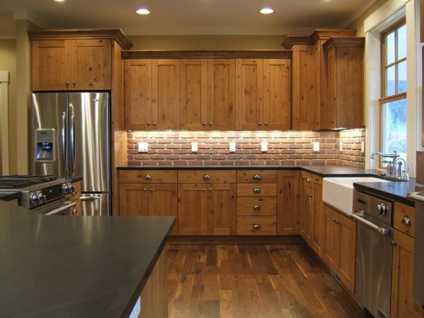 brick backsplash in kitchen table chandelier backsplashes for warm and inviting cooking areas view gallery cozy with