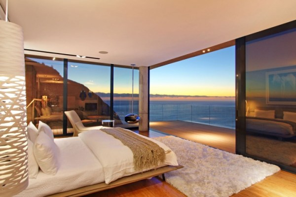 modern bedroom with ocean view Villa Built Into The Mountain With Full Ocean Views From Nearly Every Room