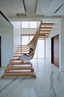Sculptural Staircase Defines A Modern Two Storey Apartment ...