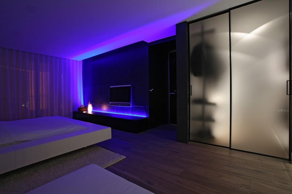 living room decor blue walls corner furniture bold contrasts break the monochrome décor of a chic apartment