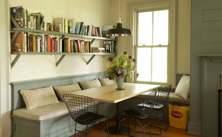 corner kitchen seating navy rug ways of integrating tables in your decor add some reading material on shelves