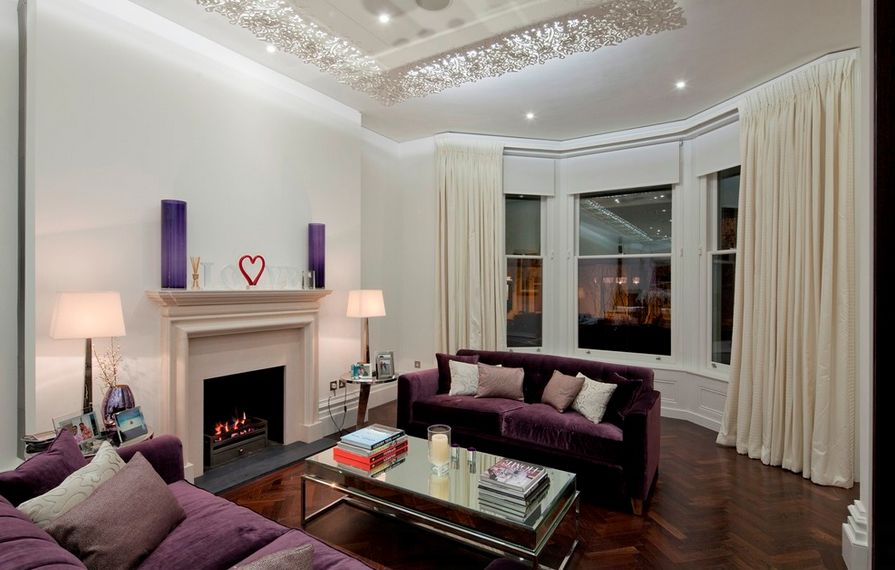 living rooms with light grey couches wallpaper ideas for room feature wall how to match a purple sofa your décor