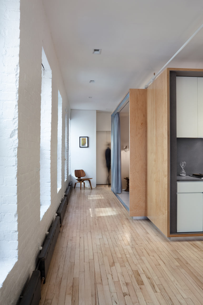 Modern Loft Removes Partitions In Favor Of A Plywood Volume