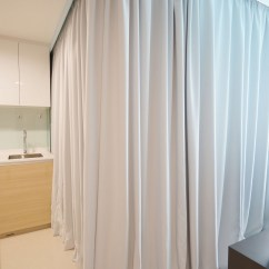 Curtains For Small Living Room Apartment Therapy Storage Tiny Uses Fabric To Divide Its Spaces