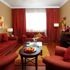 Orange Living Room Decorating Ideas Chocolate Brown Couches 20 Colors That Jive Well With Red Rooms