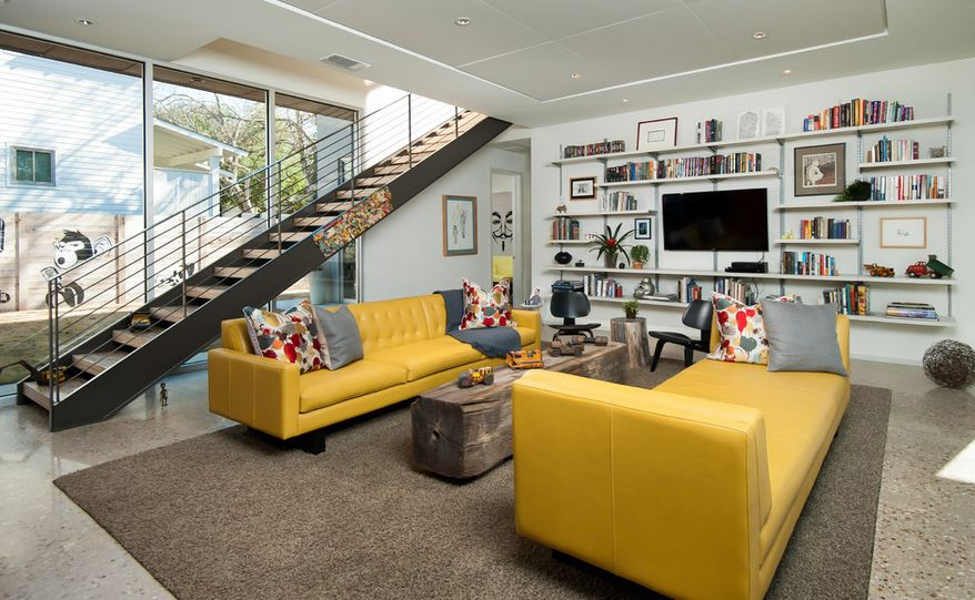 yellow chairs for living room color furniture how to design with and around a sofa interior of loft featuring two couches