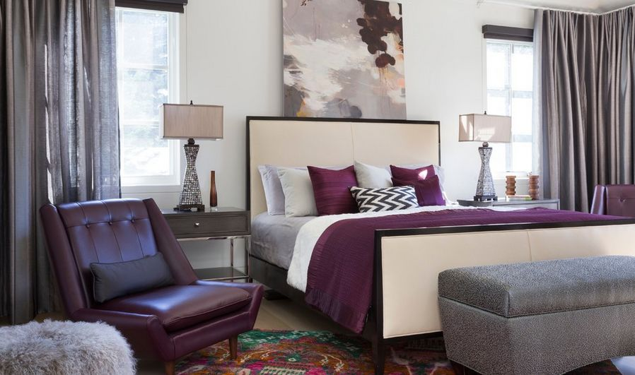 Accent colors bedroom with bed placed between windows