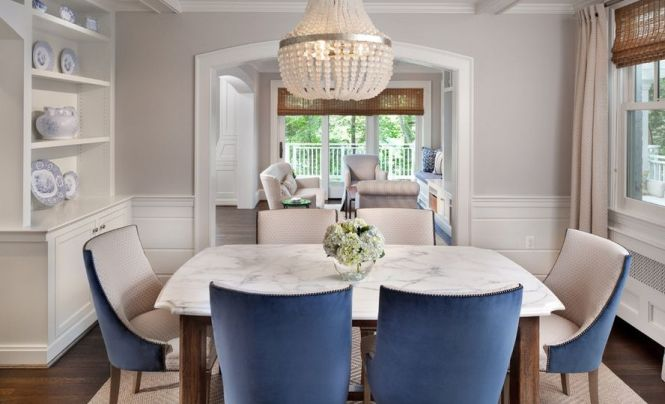 Beautiful Dining Room With Marble Table And Beaded Chandelier Above